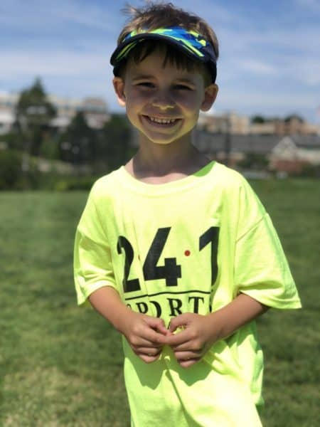 Smiling boy at summer youth sports camp